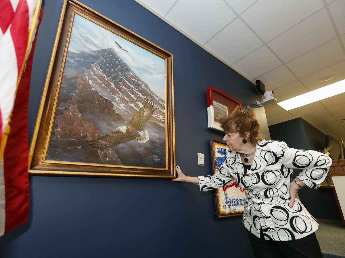 359th state District Court Judge Kathleen Hamilton shares the story behind a painting titled 'Freedom'done by a man convicted in 2004 of felony drug charges that is now displayed in her courtroom, June 30, 2021, in Conroe.