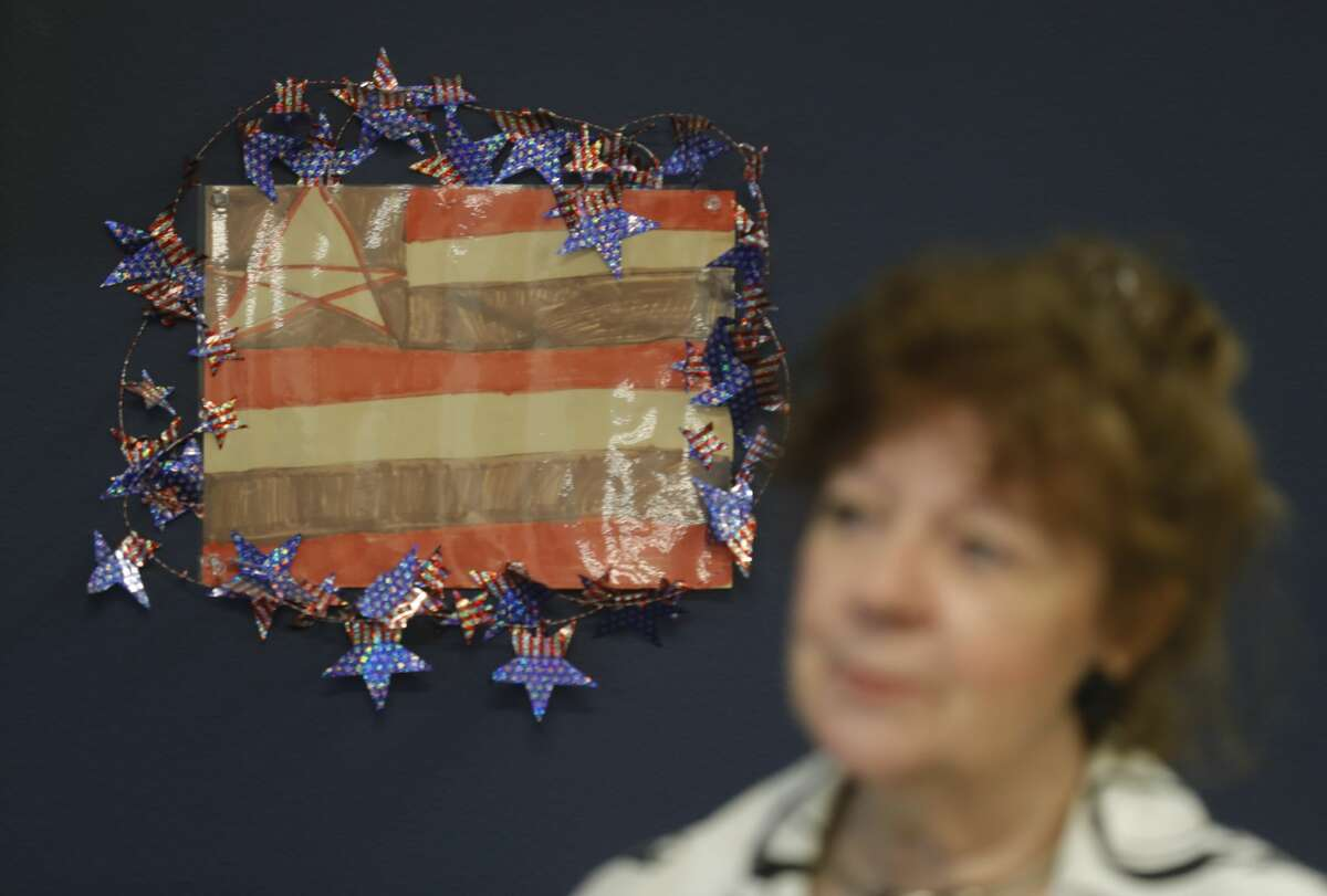 359th state District Court Judge Kathleen Hamilton shares how they once used a flag illustration by a girl in a family law case to say the national anthem in her courtroom, June 30, 2021, in Conroe.