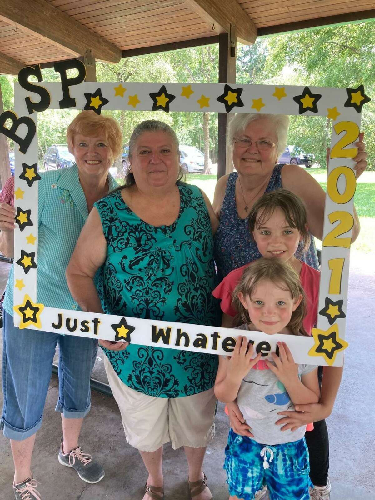 """Members of the Theta Master chapter of Beta Sigma Phi fill a frame during the """"Just Whatever"""" picnic in June at Stevenson Park, 1100 S. Friendswood Drive. From left are: Theta Master President Shirley McGuire, of Pearland; Rosa Vance, of Hitchcock; Linda Abbott, of Friendswood, and Ellouise and Skylar Vance, both of Pearland. For membership information, contact Judy Hotman, 713-724-3154."""