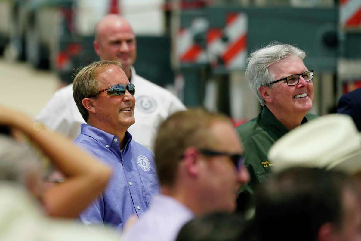 Texas Attorney General Ken Paxton, left, and Texas Lt. Gov. Dan Patrick, right, listen to Former President Donald Trump speak during a visit to an unfinished section of border, in Pharr, Texas, Wednesday, June 30, 2021. Paxton has vowed to resist President Joe Biden's latest push for greater outreach to stop the spread of COVID-19.