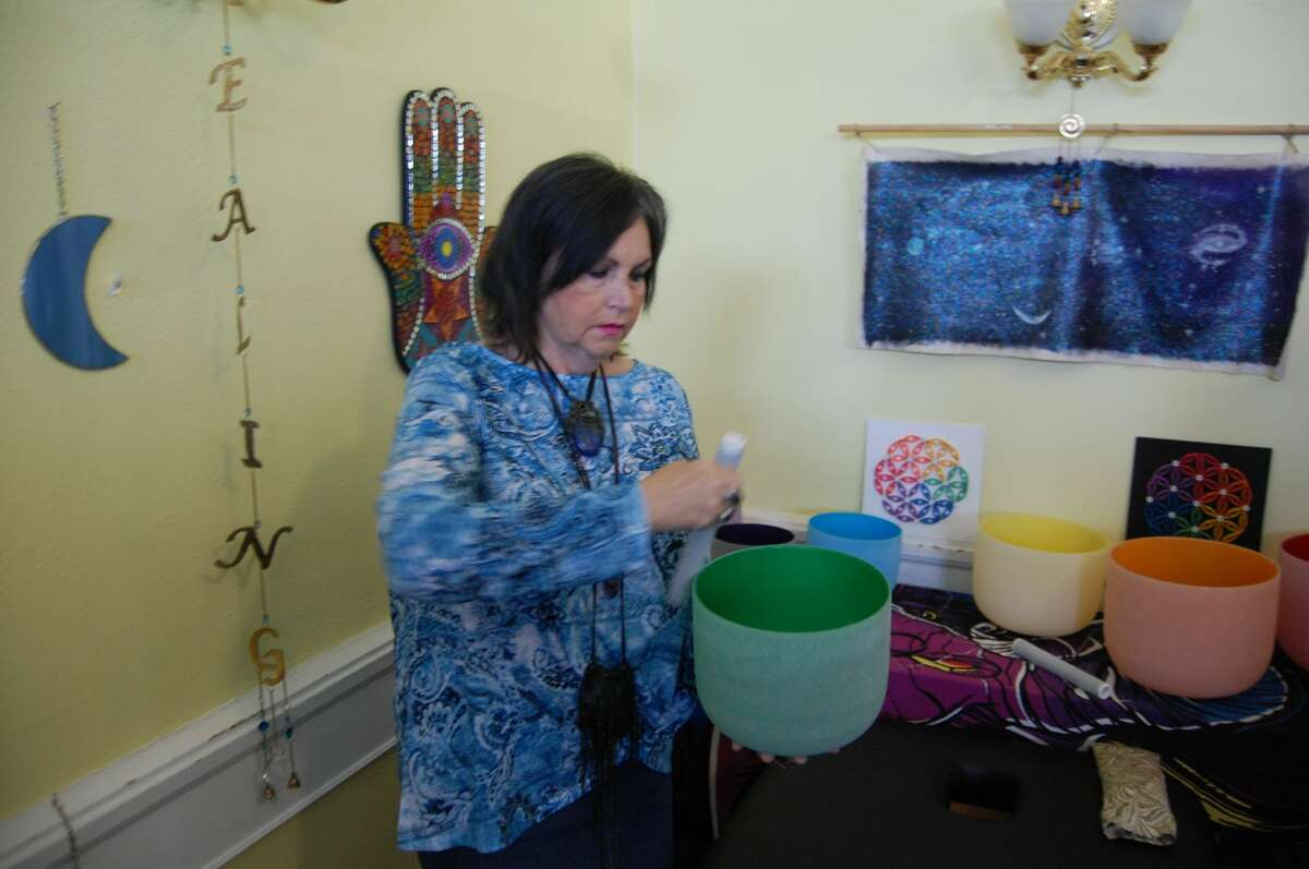Donna Nunnally displays sound waves of vibration on a specialized drum at It's Raining Zen.