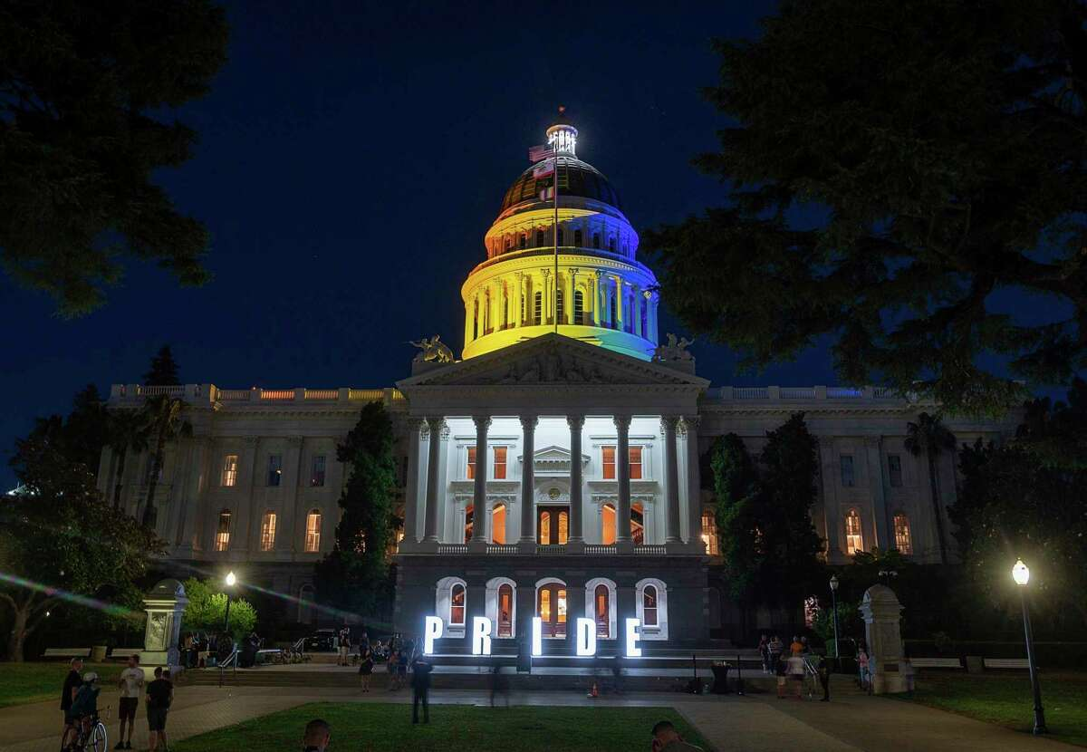 The California state Capitol in Sacramento is illuminated in rainbow colors to celebrate LGBT Pride month on June 21, 2021. California has reinstated a mask mandate for all legislators and employees at the Capitol regardless of vaccination status following an outbreak of nine COVID-19 cases there.