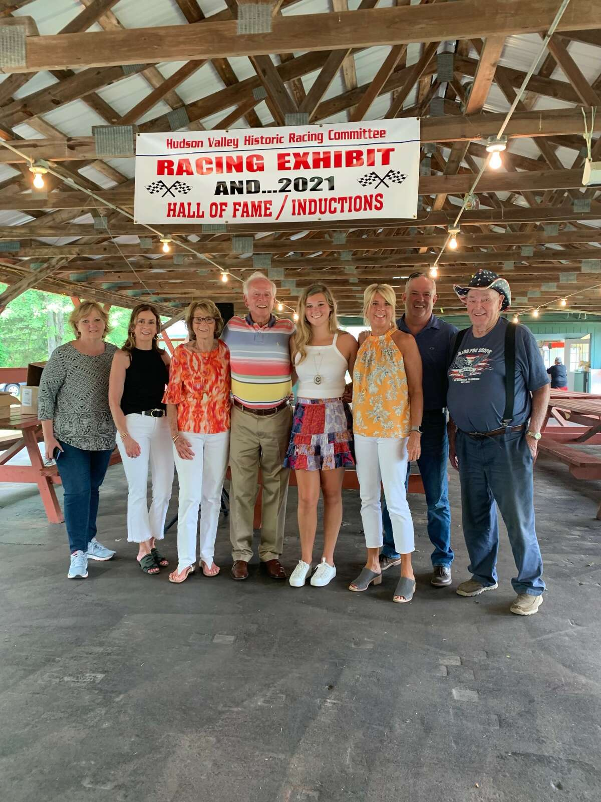 Driver Ernie Marshall, fourth from left, is joined at his Hudson Valley Historic Racing Hall of Fame induction ceremony by, from left, Kathy Wiltse Marano, daughter Linda Marshall, wife Nancy Marshall, granddaughter Jenni Zackeo, daughter Karen Marshall Ivey, son-in-law Justin Ivey and Eel Wiltse.