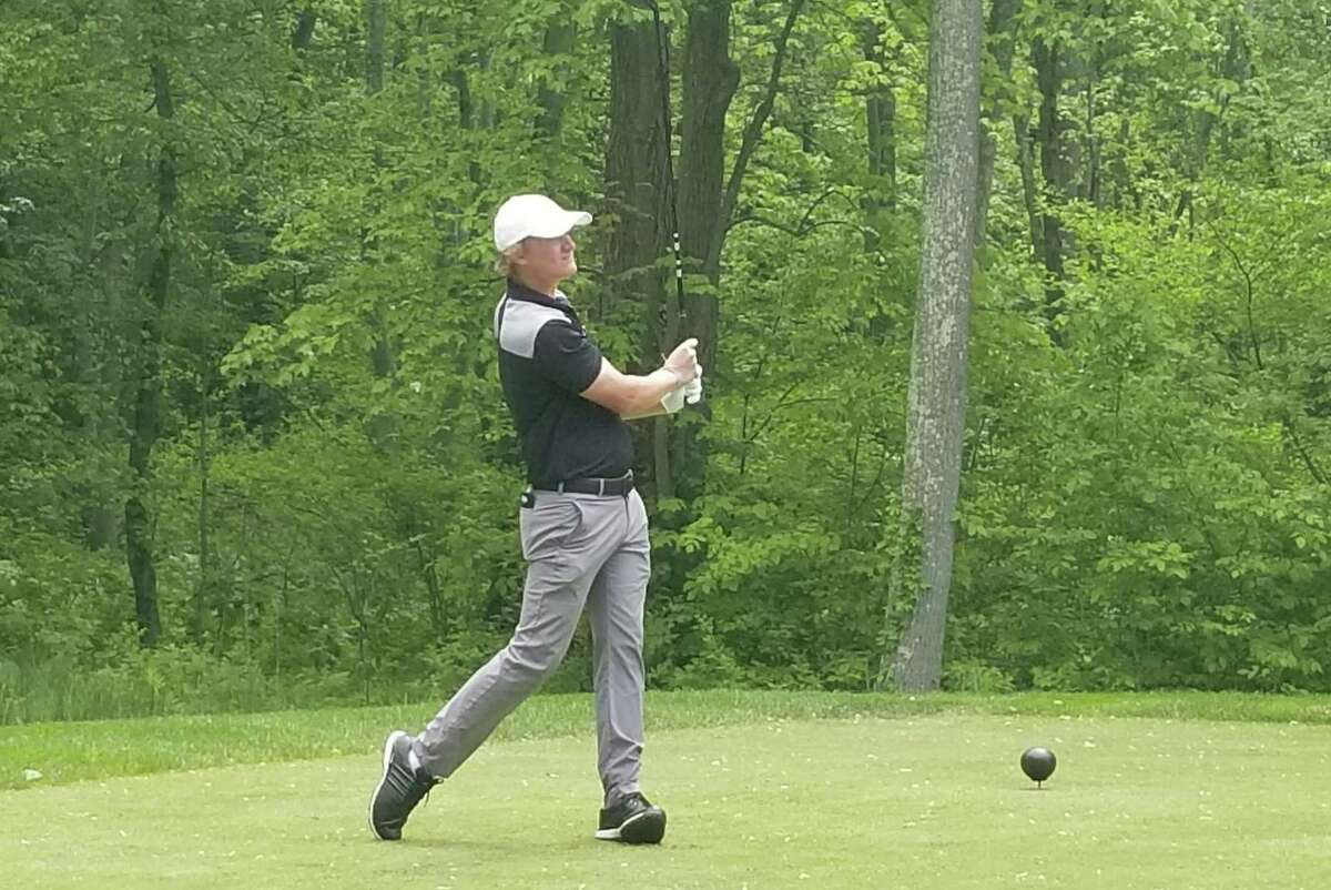 Hand's Matt Doyle tees off on the 16th hole at Race Brook Country Club in Orange in May.