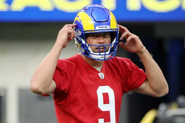 Matthew Stafford of the Los Angeles Rams calls out the play during open practice at SoFi Stadium on June 10, 2021 in Inglewood, California.