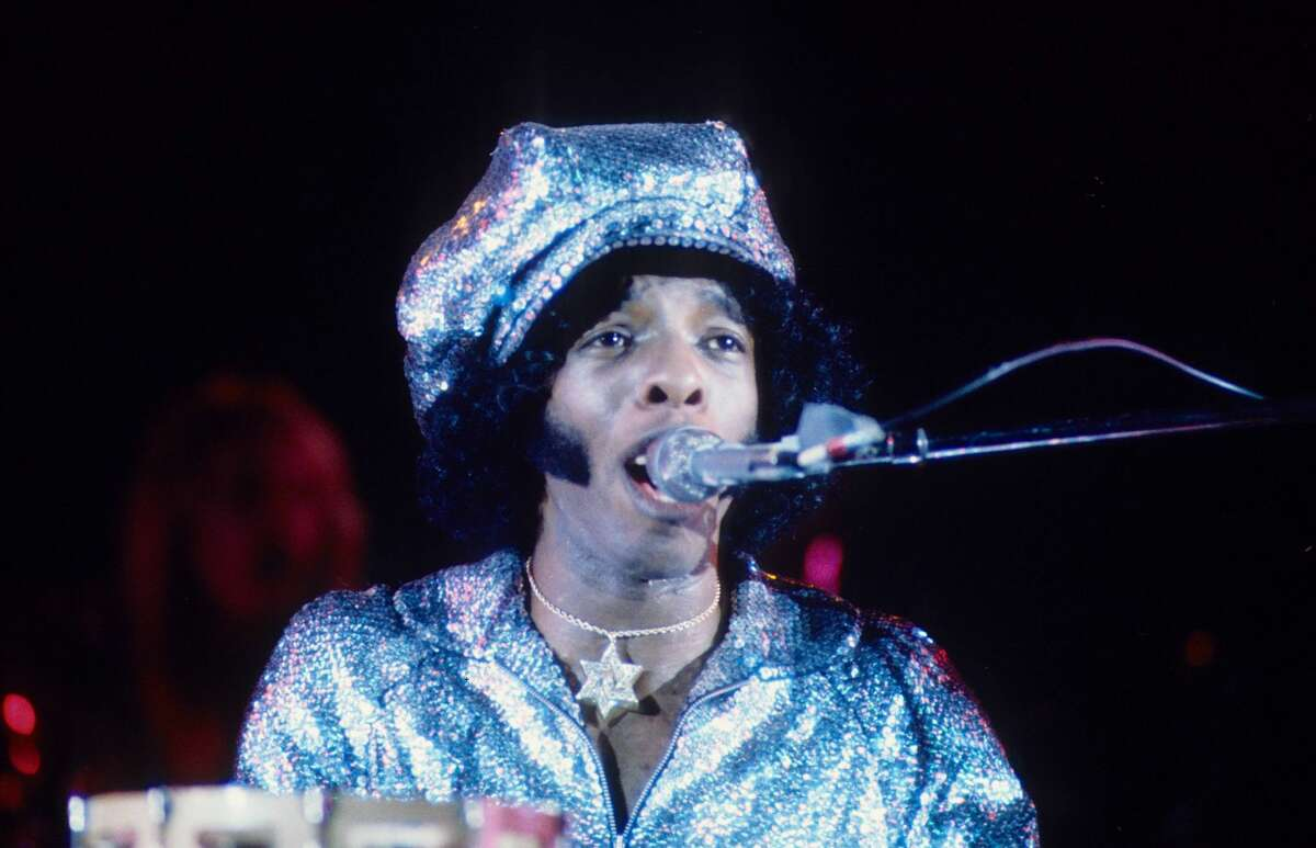 Sly Stone of Sly and the Family Stone performed on stage in July 1974 in Los Angeles.