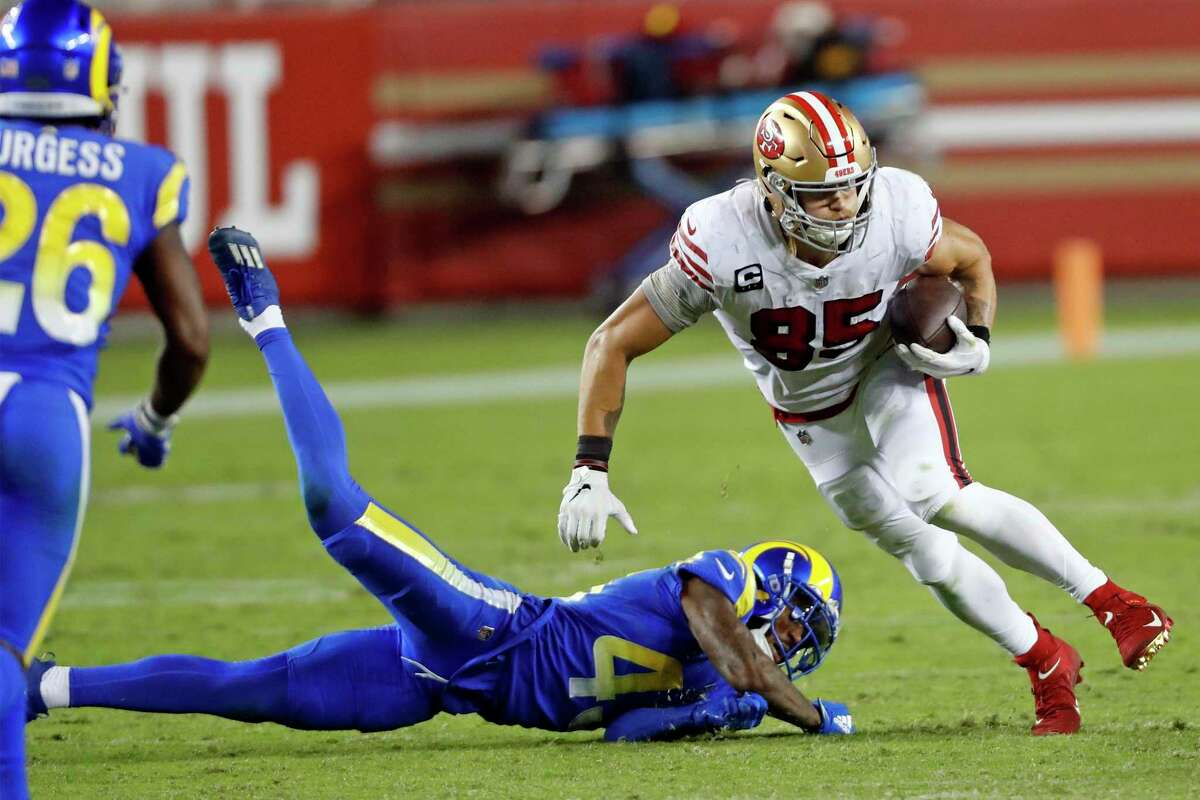 San Francisco 49ers' George Kittle runs for a first down after a catch in front of Los Angeles Rams' John Johnson III during Niners' 24-16 win in NFL game at Levi's Stadium in Santa Clara, Calif., on Sunday, October 18, 2020.