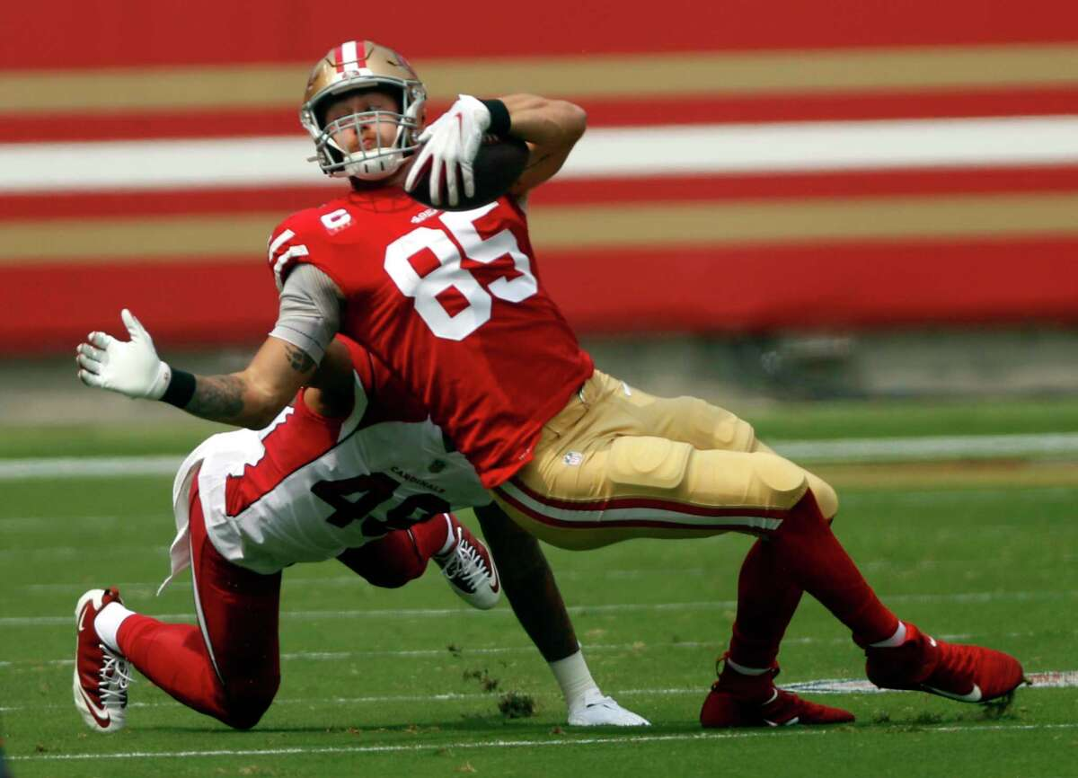 San Francisco 49ers' George Kittle is brought down by an illegal horse collar tackle by Arizona Cardinals' Isaiah Simmons in 1st quarter during NFL game at Levi's Stadium in Santa Clara, Calif., on Sunday, September 13, 2020.