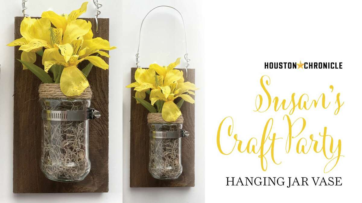 Make an awesome hanging vase using a jar and a pipe clamp