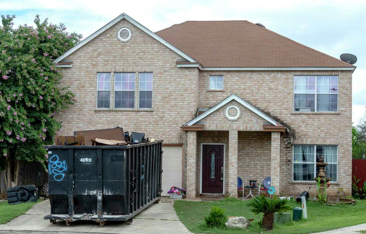 A dumpster sits in the driveway of a Dhaka View home damaged by Leon Creek flooding.
