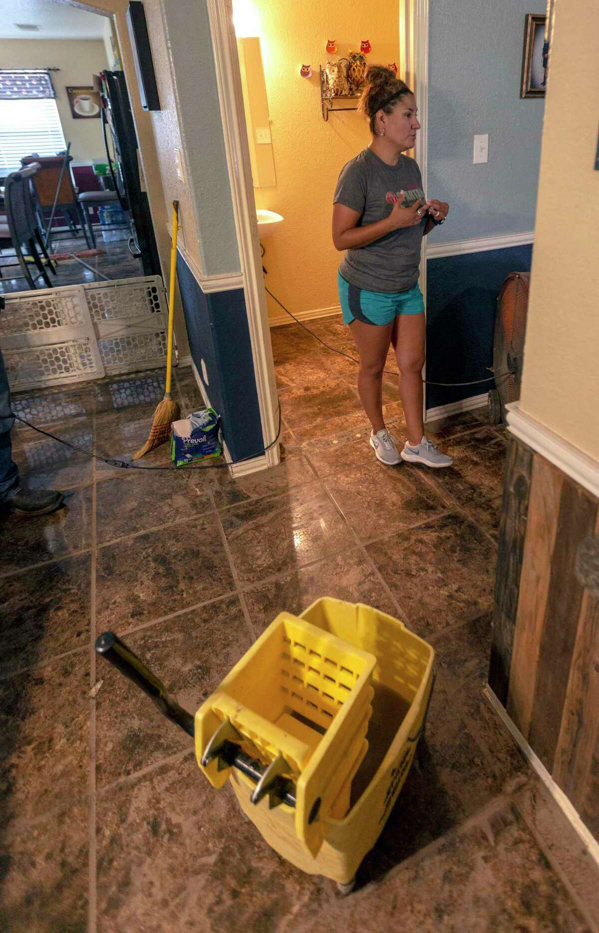Joann Felan talks about the floodwaters that swept through their home Tuesday.
