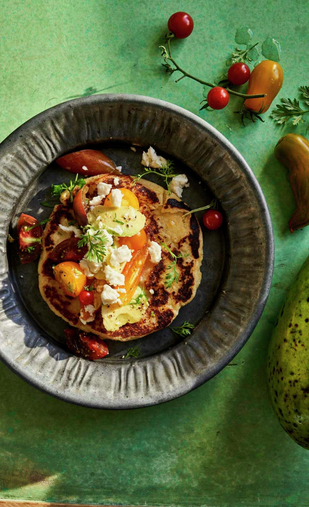 """Arepa de Choclo, a sweet corn arepa loaded with cheese, from """"Colombiana"""" by Mariana Velásquez (Harper Wave)."""