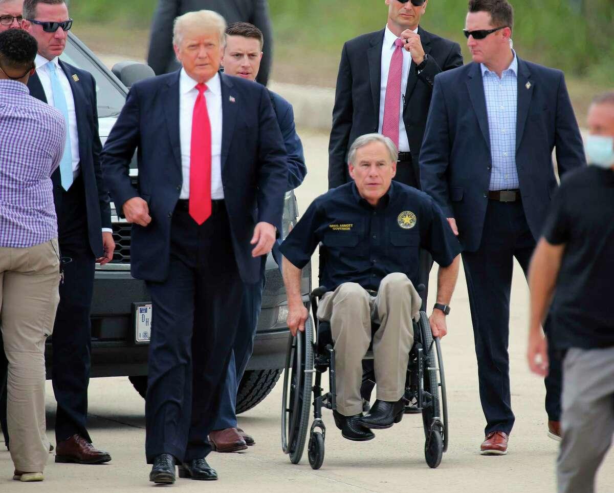 Former President Donald Trump and Texas Gov. Greg Abbott arrive near a section of the border wall on Wednesday, June 30, 2021, in Pharr, Texas. (Joel Martinez/The Monitor via AP)