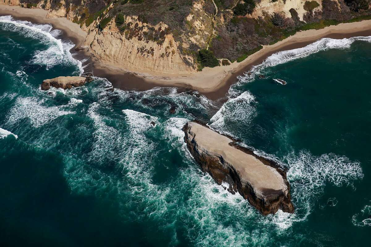A view of the coastline between Watsonville and Half Moon Bay during a helicopter flight which was chartered to search for the remains of 12-year-old boy Arunay Pruthi who was pulled into the ocean over Martin Luther King weekend at Cowell Ranch State Beach on Monday, March 1, 2021 near Half Moon Bay, California.
