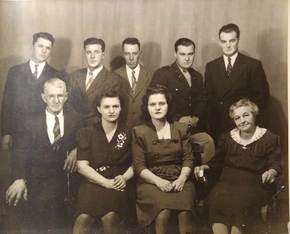 Pictured is the Howes family, including Reta Howes Russell (front, third from left).
