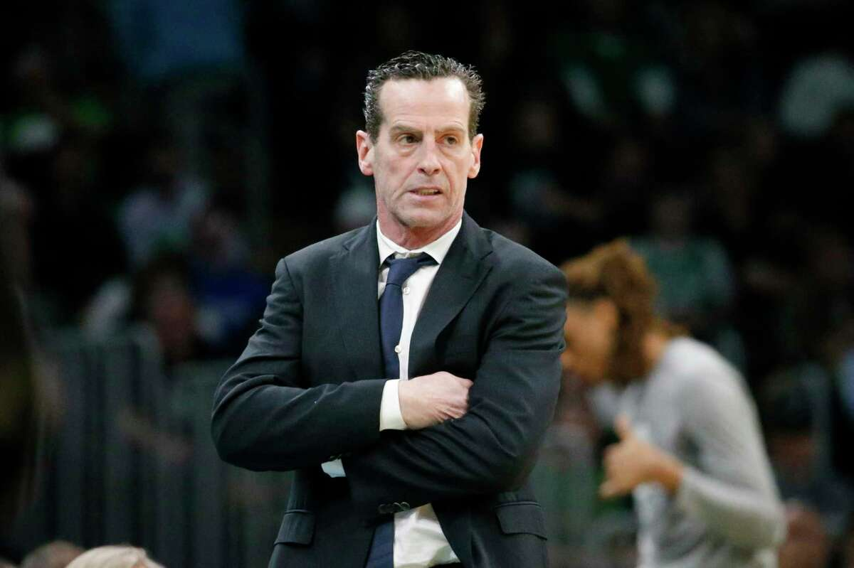 FILE - In this March 3, 2020 file photo, Brooklyn Nets head coach Kenny Atkinson looks on from the sideline during the first half of an NBA basketball game against the Boston Celtics in Boston. The Nets surprisingly split with Atkinson on Saturday, March 7, even as they remain on track for a second consecutive playoff berth. The morning after Atkinson guided the Nets to a rout of San Antonio, the Nets announced that they had mutually agreed to part ways with the fourth-year coach. (AP Photo/Mary Schwalm, File)