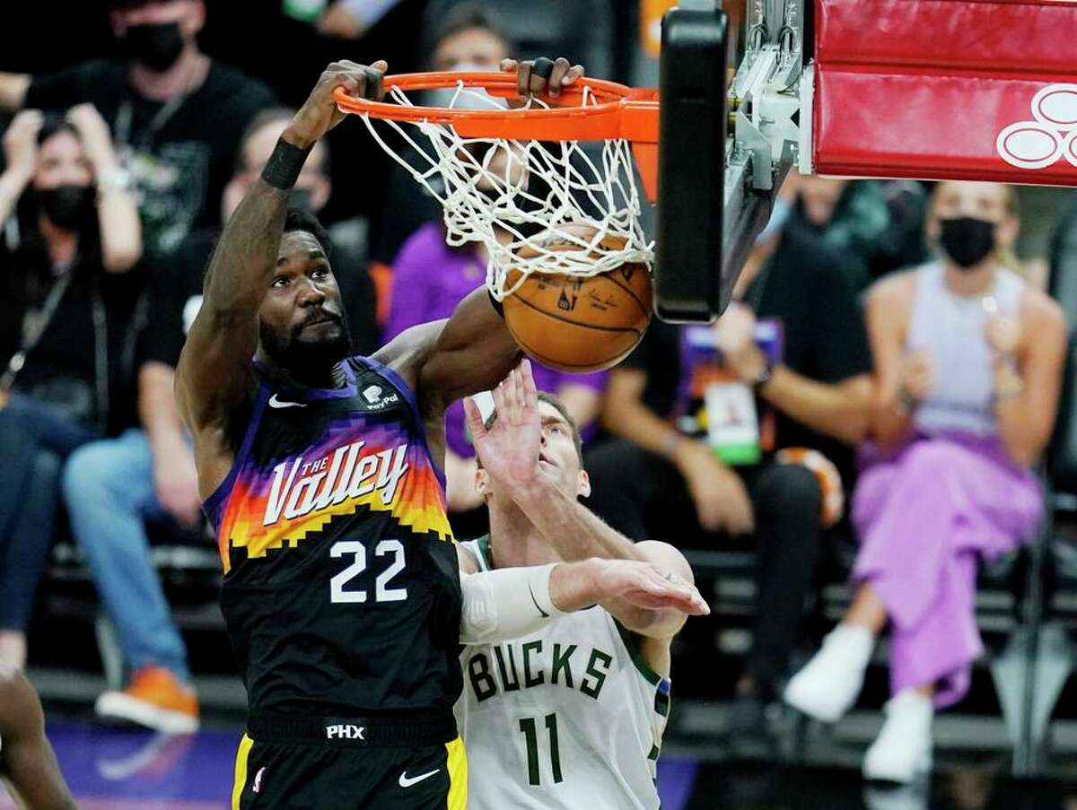 Phoenix center Deandre Ayton dunks in front of Milwaukee center Brook Lopez during the second half of the Suns' win.