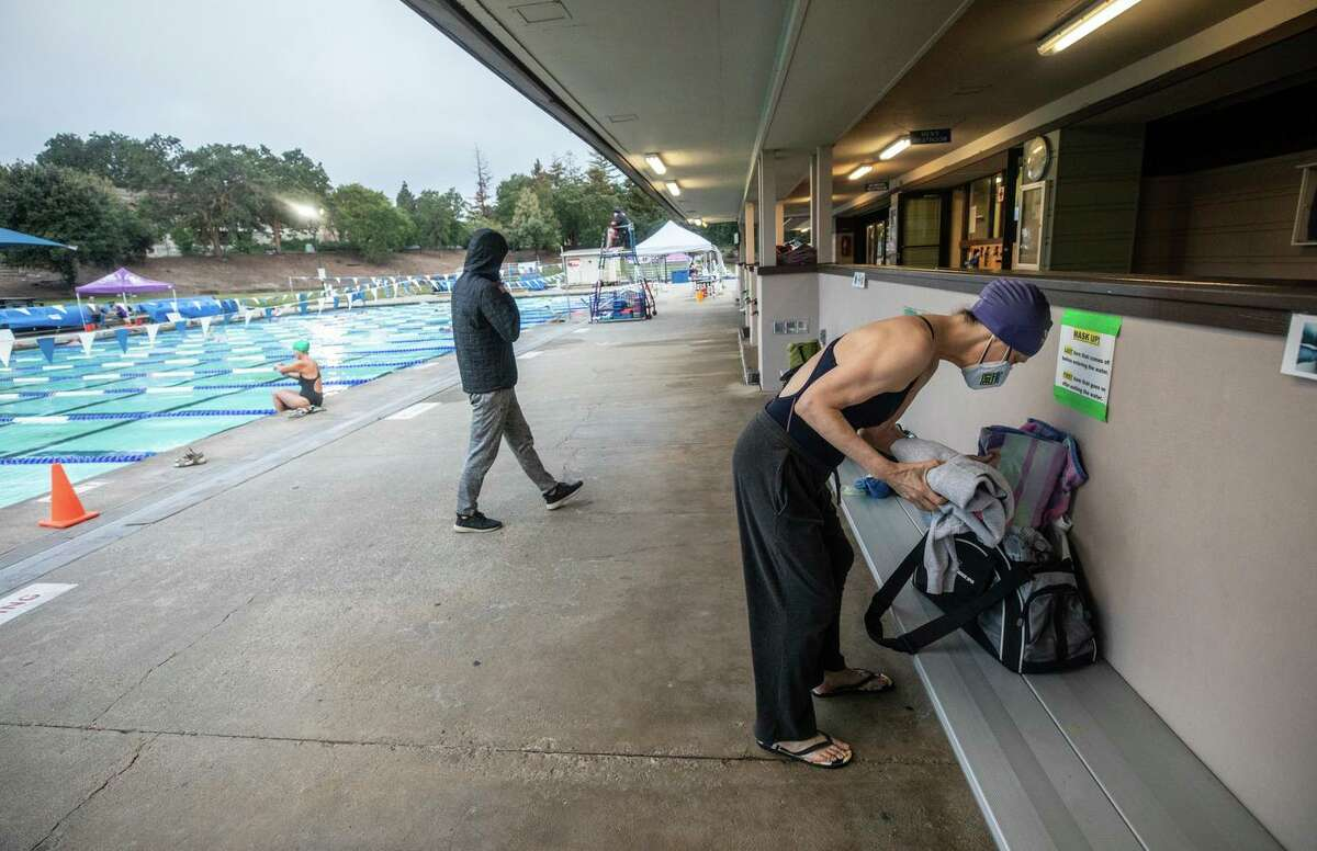 Many people are shedding masks as health restrictions ease, but Rachel Eaton, who is immunocompromised, wears hers at the Clarke Swim Center in Walnut Creek.