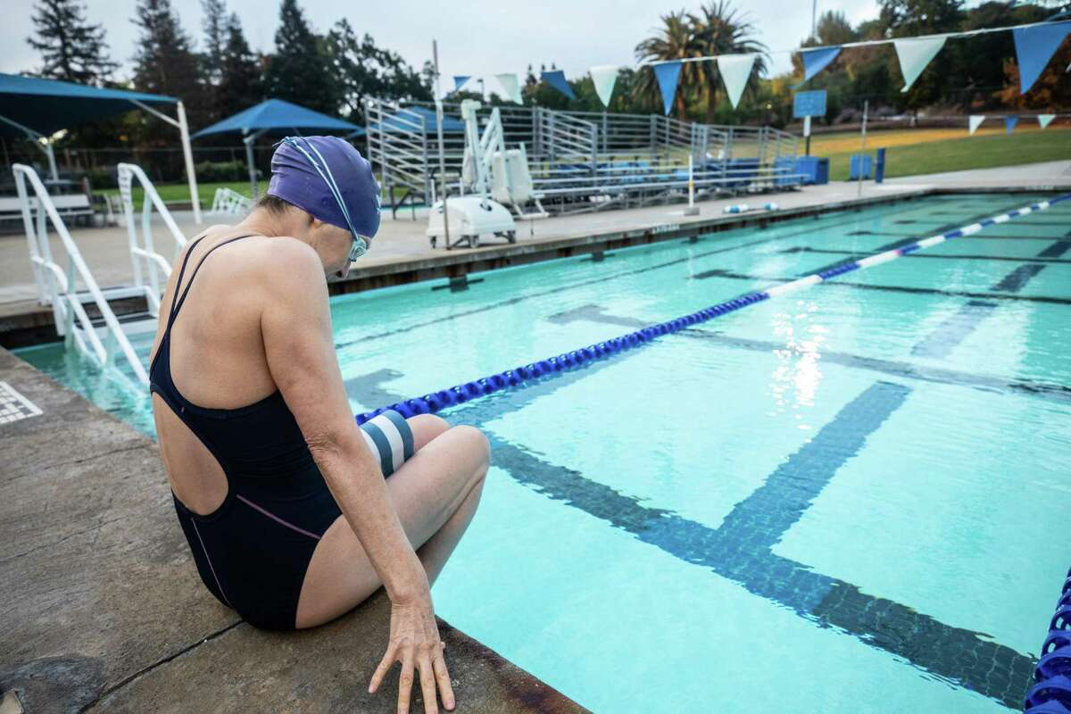 Rachel Eaton gets ready to swim at the Clarke Swim Center in Walnut Creek on Friday morning. Eaton, who received a kidney transplant, is immunocompromised and at higher risk for becoming seriously ill from COVID-19.