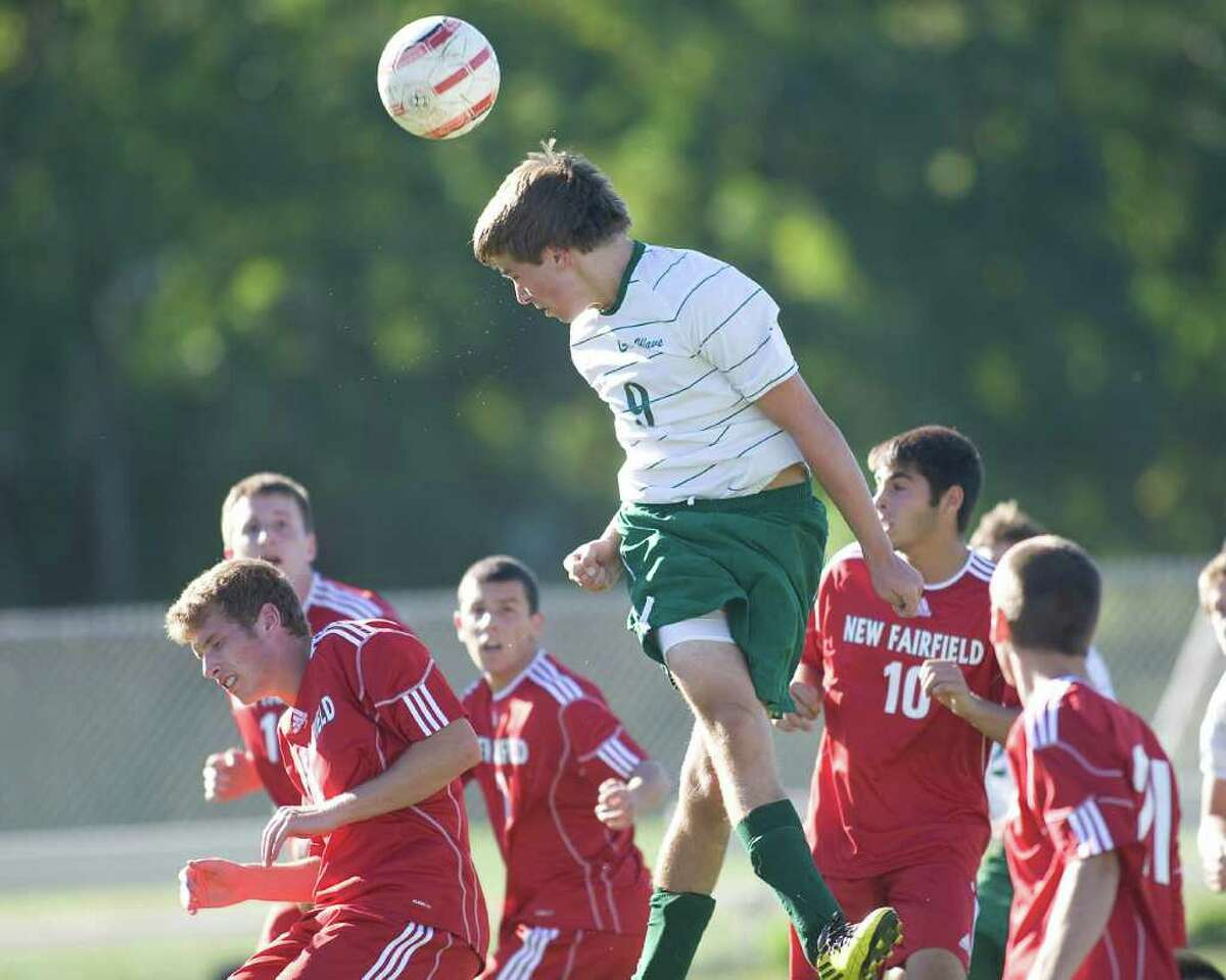 New Milford's Luke Stolz (9) tries to get his head on a corner kick against New Fairfield Tuesday at New Milford High.