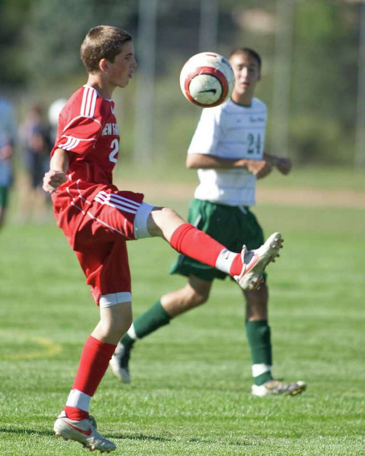 New Fairfield's Dan Silva gains control of the ball against New Milford Tuesday at New Milford High.