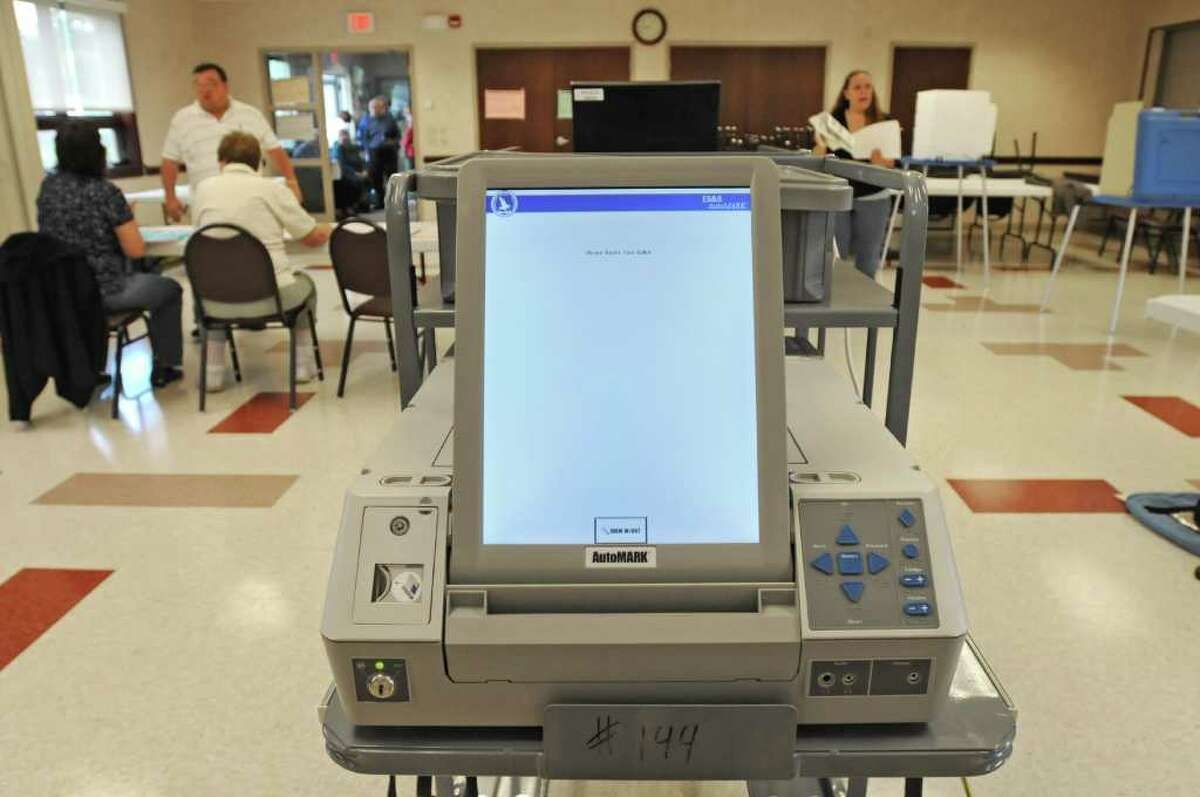 A new handicap-accessible voting machine is available at the Western Turnpike Rescue Squad polling place in Guilderland on September 14, 2010. (Lori Van Buren / Times Union)