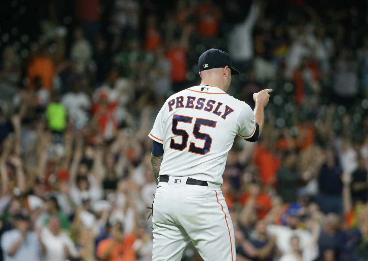 Houston Astros relief pitcher Ryan Pressly (55) celebrates after earning the save against the Oakland Athletics during an MLB game at Minute Maid Park on Wednesday, July 7, 2021, in Houston. The Astros won 4-3.