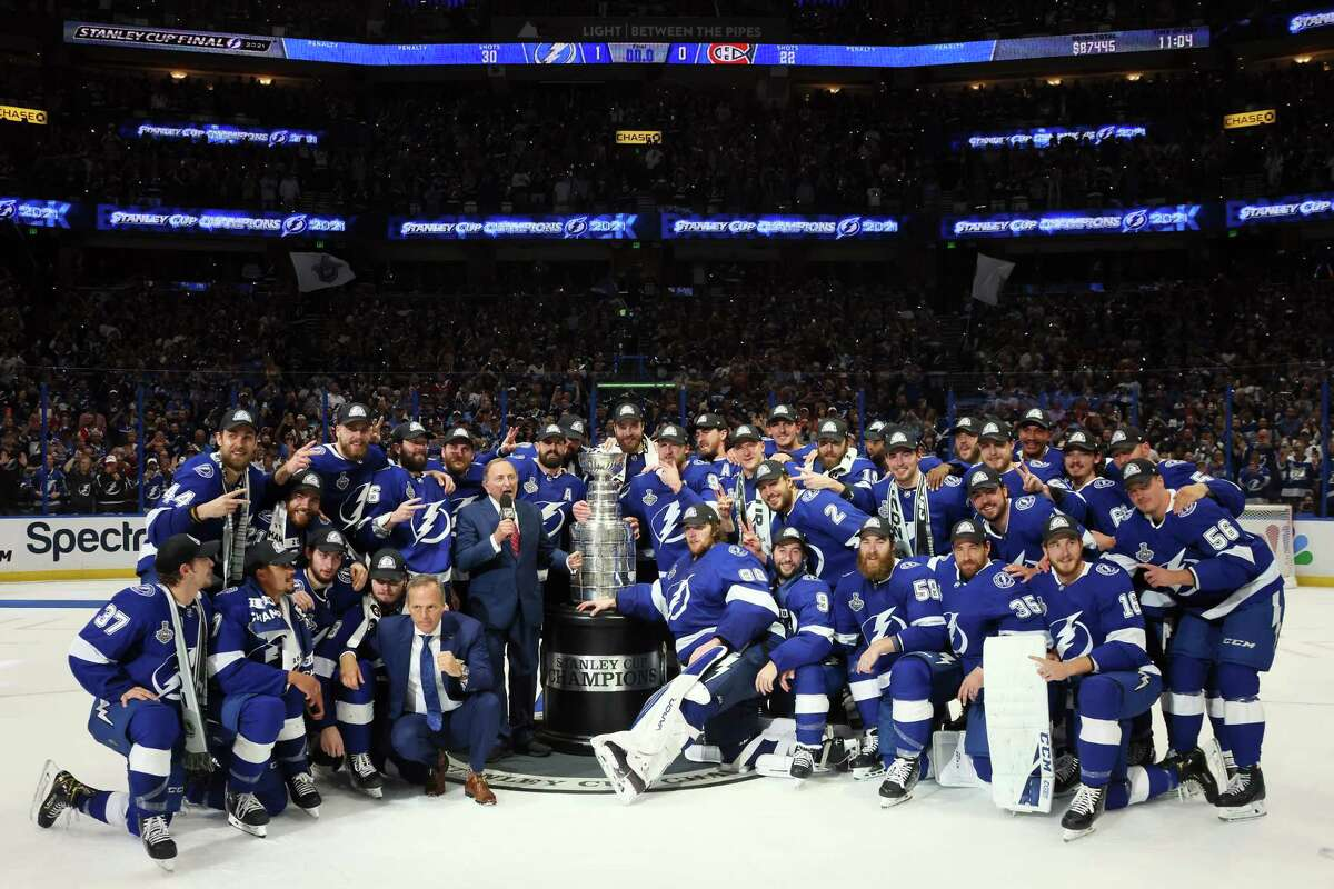 The Tampa Bay Lightning pose with the Stanley Cup after defeating the Montreal Canadiens 1-0 in Game Five to win the 2021 Stanley Cup Final on Wednesday in Tampa, Fla.