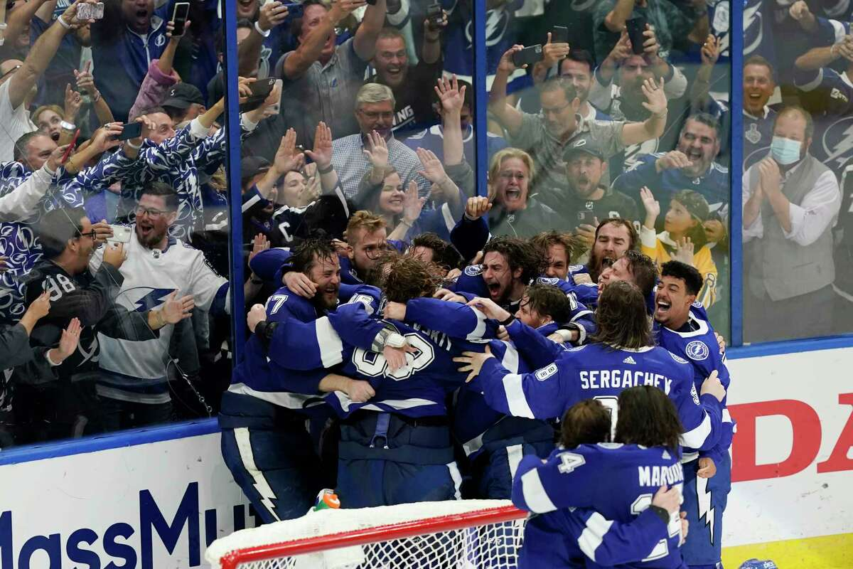 The Tampa Bay Lightning celebrate their series win over the Montreal Canadiens to clinch the Stanley Cup in Game 5 of the Stanley Cup Final on Wednesday in Tampa, Fla.