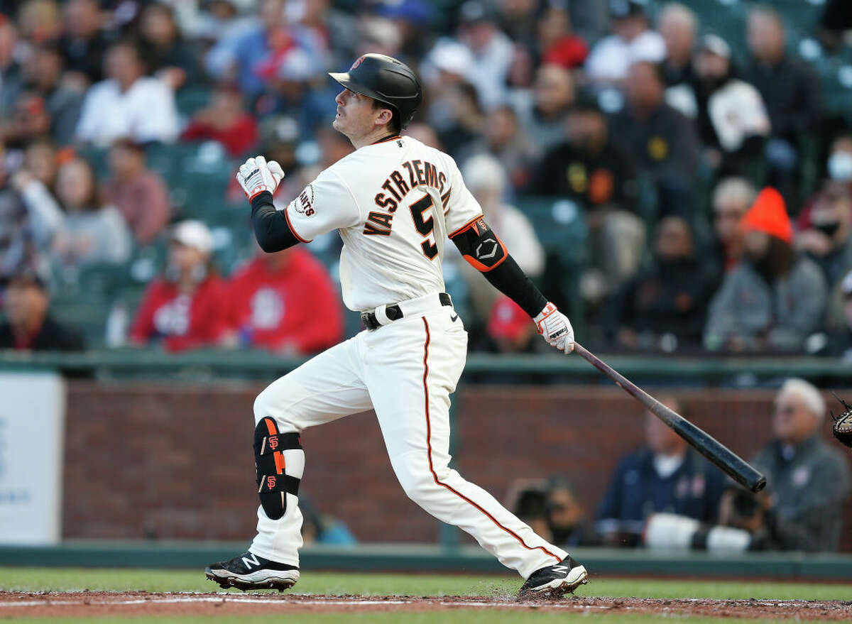 Mike Yastrzemski of the San Francisco Giants hits an RBI double in the bottom of the second inning against the St. Louis Cardinals at Oracle Park on July 07, 2021.