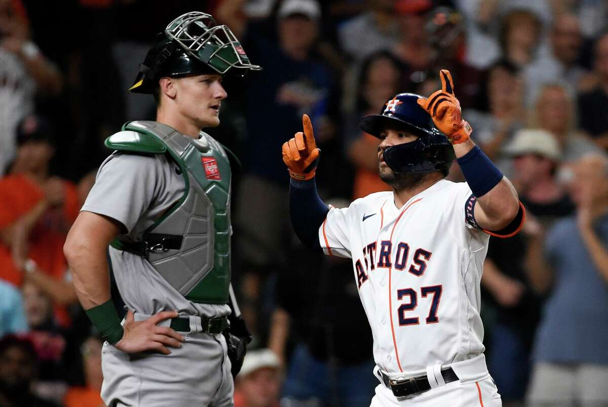 The Astros' Jose Altuve (27) celebrates his three-run home run next to Oakland Athletics catcher Sean Murphy during the third inning of a baseball game Wednesday, July 7, 2021, in Houston. (AP Photo/Eric Christian Smith)