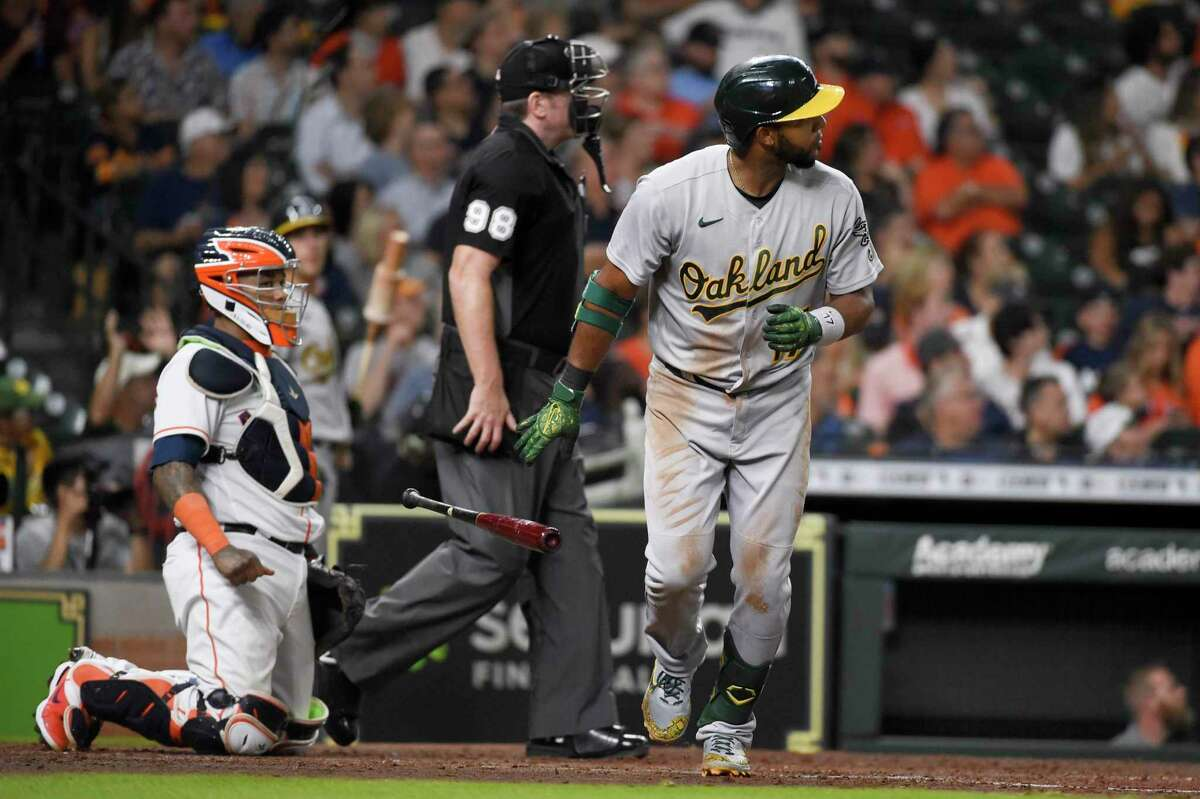 Oakland Athletics' Elvis Andrus, right, watches his solo home run during the sixth inning of the team's baseball game against the Houston Astros, Wednesday, July 7, 2021, in Houston. (AP Photo/Eric Christian Smith)