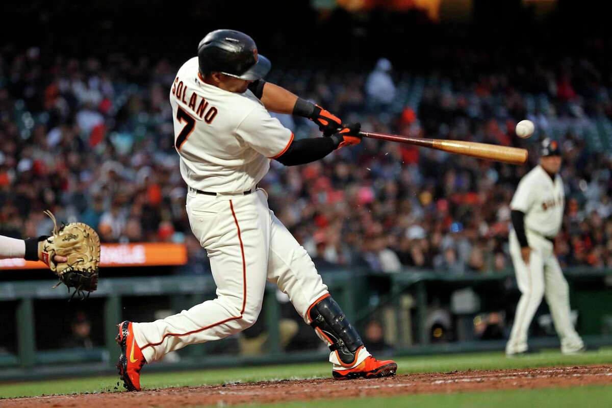 San Francisco Giants' Donovan Solano hits an RBI double in 5th inning against St. Louis Cardinals during MLB game at Oracle Park in San Francisco, Calif., on Wednesday, July 7, 2021.