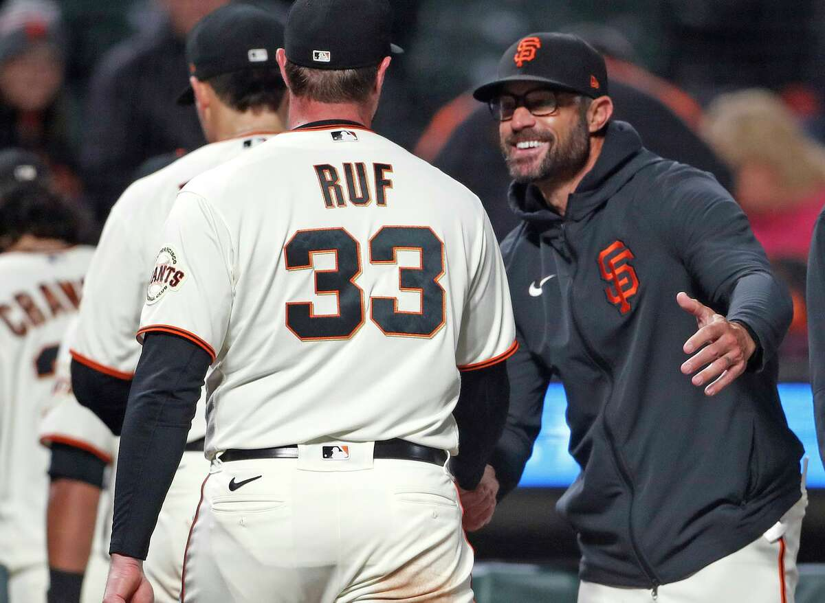 San Francisco Giants' manager Gabe Kapler greets Darin Ruf after 5-2 win over St. Louis Cardinals during MLB game at Oracle Park in San Francisco, Calif., on Wednesday, July 7, 2021.