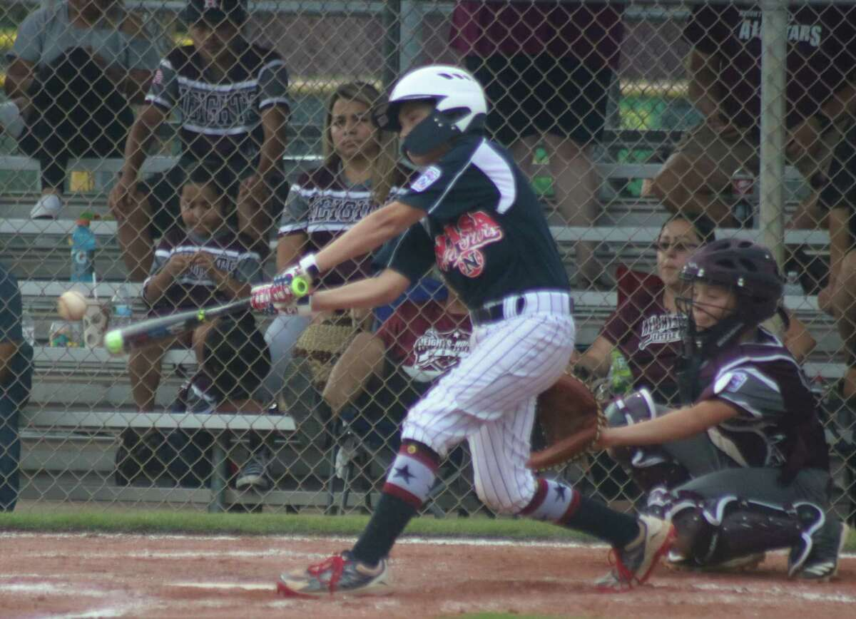 NASA 12s batter Carter Grillo connects for the first of two doubles Wednesday night. He would come back two innings later and drive in what proved to be the game-winning run with his second two-bagger.