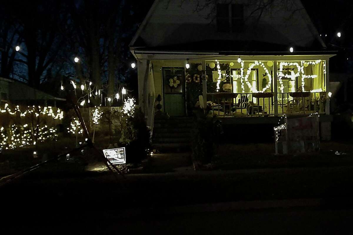 """In March, Niky Housewas driving home from work and saw this word spelled out in lights: """"HOPE."""" Jenn Vande Zande of Midland had put up the first two letters of the word sometime last fall. Around Christmas time, she was in the hospital for about a week. During that time, her husband, Jeff Vande Zande, put up the last two letters and then took a picture of the completed message to share with his wife. (Photo by Niky House)"""