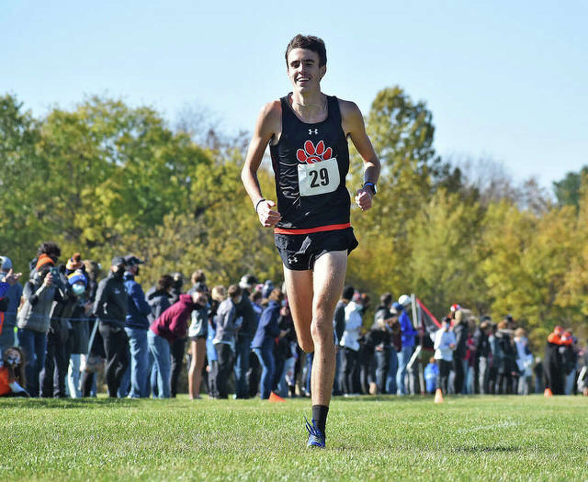 Edwardsville junior Ryan Watts allows himself to smile as he approaches the finish line alone in first place at the Class 3A sectional meet in Normal. Watts is the 2020 Telegraph Large-Schools Boys Cross Country Runner of the Year.