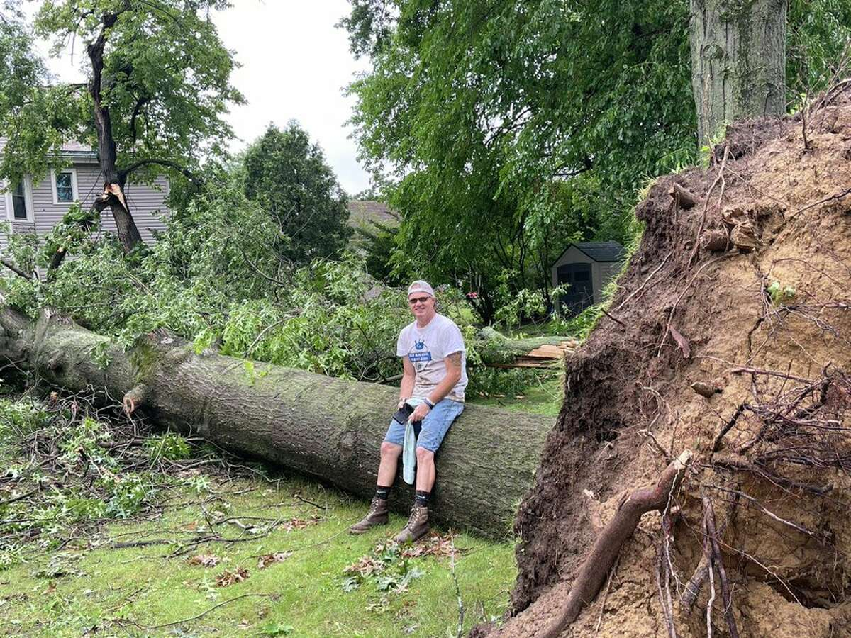 """Trees were down all over the village of Coxsackie July 8, 2021 after a storm the day before, including this giant oak toppled at the corner of Washington and Lafayette avenues. Michael Oathart was at school at the time: """"The doors were rattling and we knew something serious was coming through."""""""