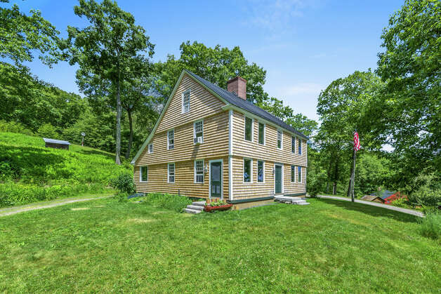 The Josiah Curtis House was built in 1780 in Wethersfield, but it was relocated to the 85 and 83 ScovilleOre Mine Road property and put on a concrete slab in the 1980s. View listing Photo: Noah Butler / Alpha Photography