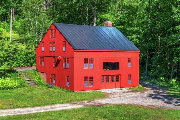 The Elijah Marshal Barn was built in 1838, but it was relocated to the 85 and 83 ScovilleOre Mine Road property and put on a concrete slab in the 1980s. View listing Photo: Noah Butler / Alpha Photography