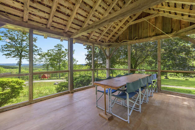 TheJosiah Curtis House has a screened-in porch off the back of the home. View listing Photo: Noah Butler / Alpha Photography