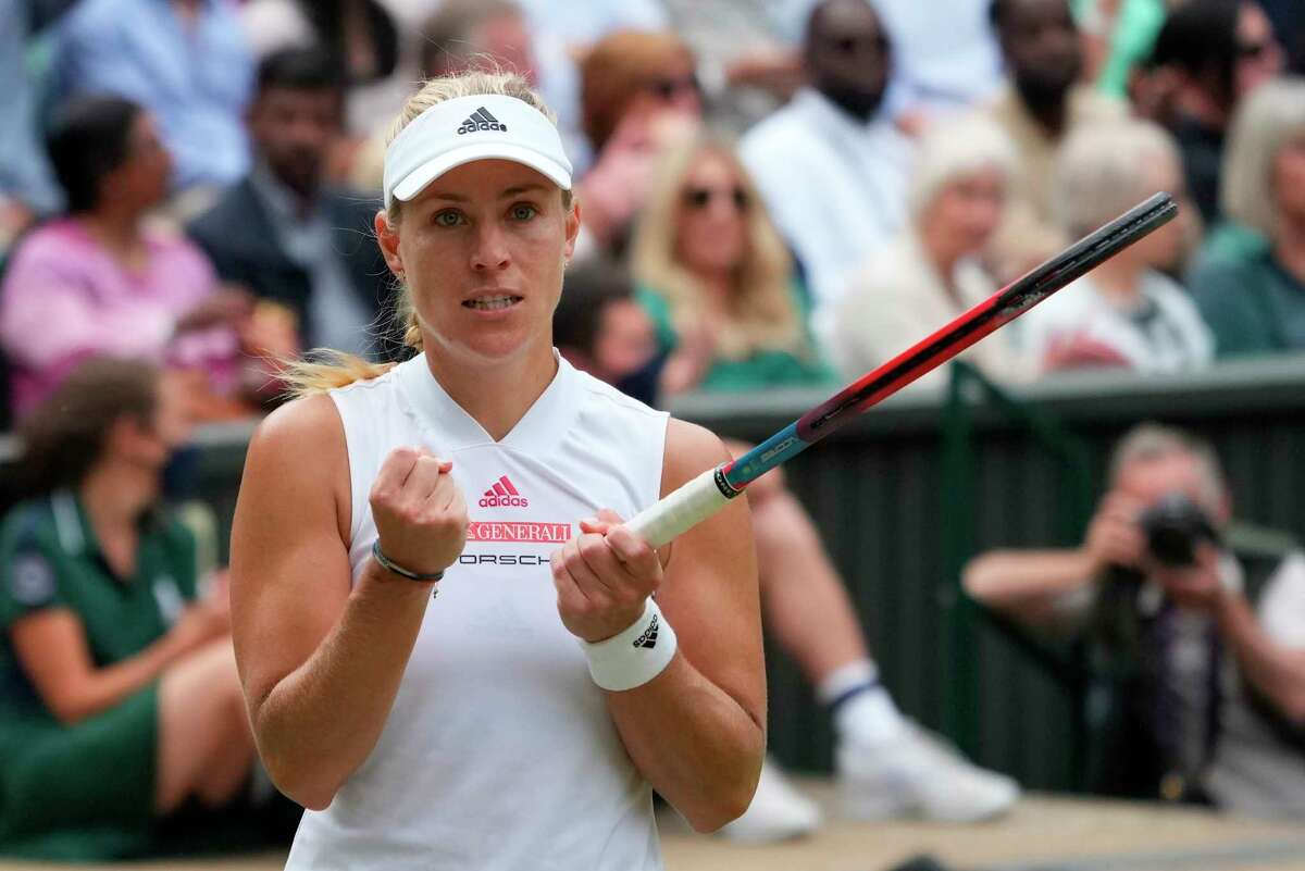 Germany's Angelique Kerber celebrates winning a point against Australia's Ashleigh Barty during the women's singles semifinals match on day ten of the Wimbledon Tennis Championships in London, Thursday, July 8, 2021.