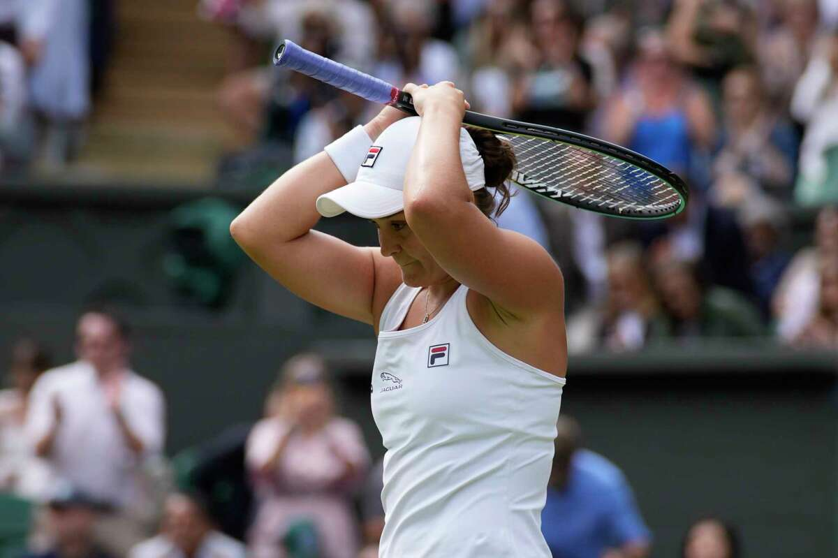 Australia's Ashleigh Barty celebrates after defeating Germany's Angelique Kerber during the women's singles semifinals match on day ten of the Wimbledon Tennis Championships in London, Thursday, July 8, 2021.