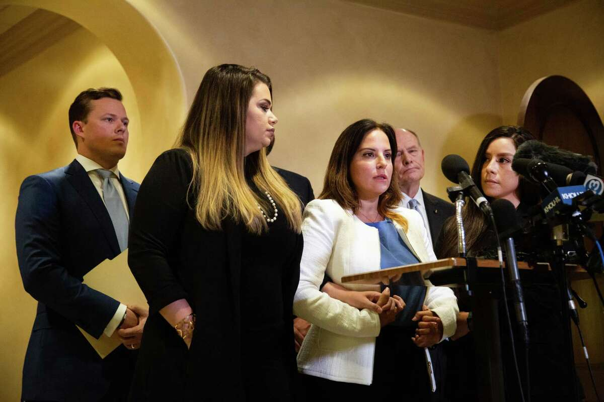 Known human-trafficking advocate Jacquelyn Aluotto, center, talks to members of the press about alleged sexual misconduct against female deputies, Monday, May 24, 2021, in Houston.