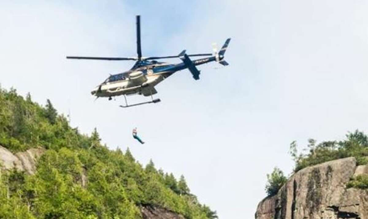 Rangers and State Police used a helicopter to hoist an injured woman off the Adirondacks Trap Dike on July 4.