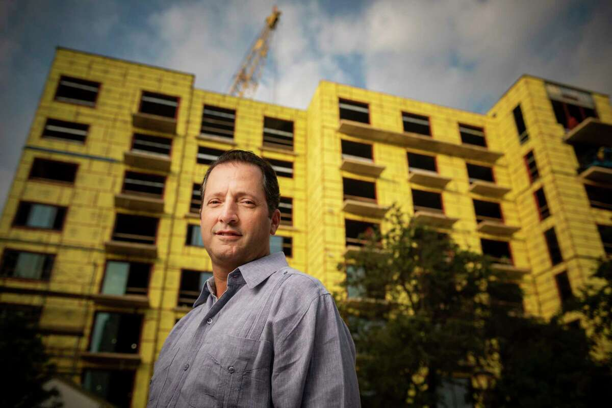 San Antonio developer David Adelman stands in front of his newest apartment bulding The '68 at Hemisfair in San Antonio on Wednesday, September, 26, 2018.