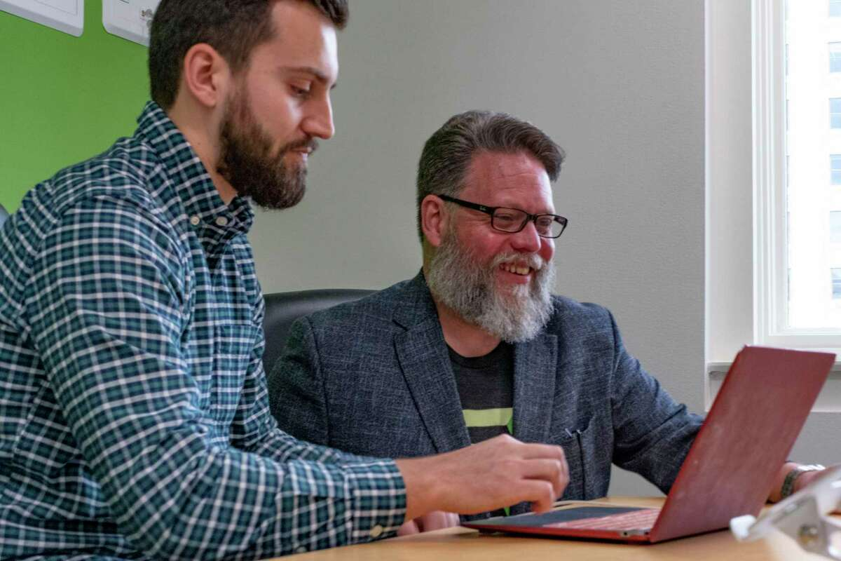 Jason Straughan, right, founder and CEO of CodeUp, sits with Stuart Rowe, admiissions manager, at CodeUp on Wednesday, July 7, 2021.
