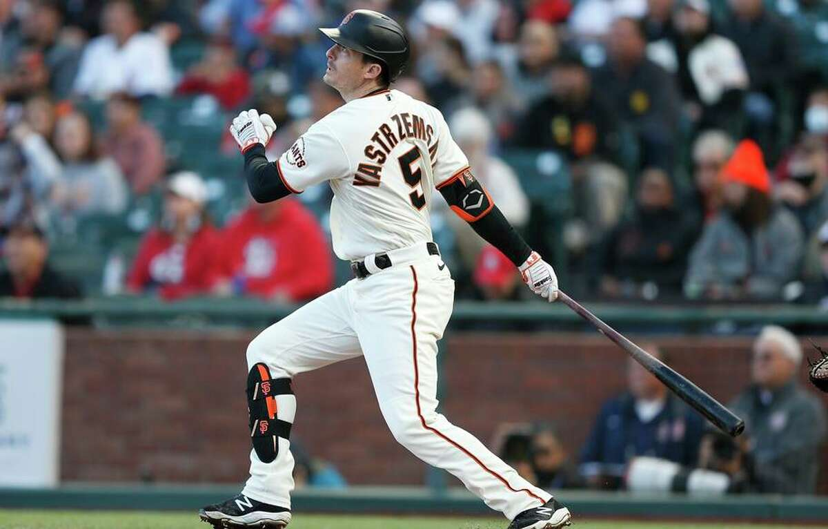 SAN FRANCISCO, CALIFORNIA - JULY 07: Mike Yastrzemski #5 of the San Francisco Giants hits an RBI double in the bottom of the second inning against the St. Louis Cardinals at Oracle Park on July 07, 2021 in San Francisco, California. (Photo by Lachlan Cunningham/Getty Images)