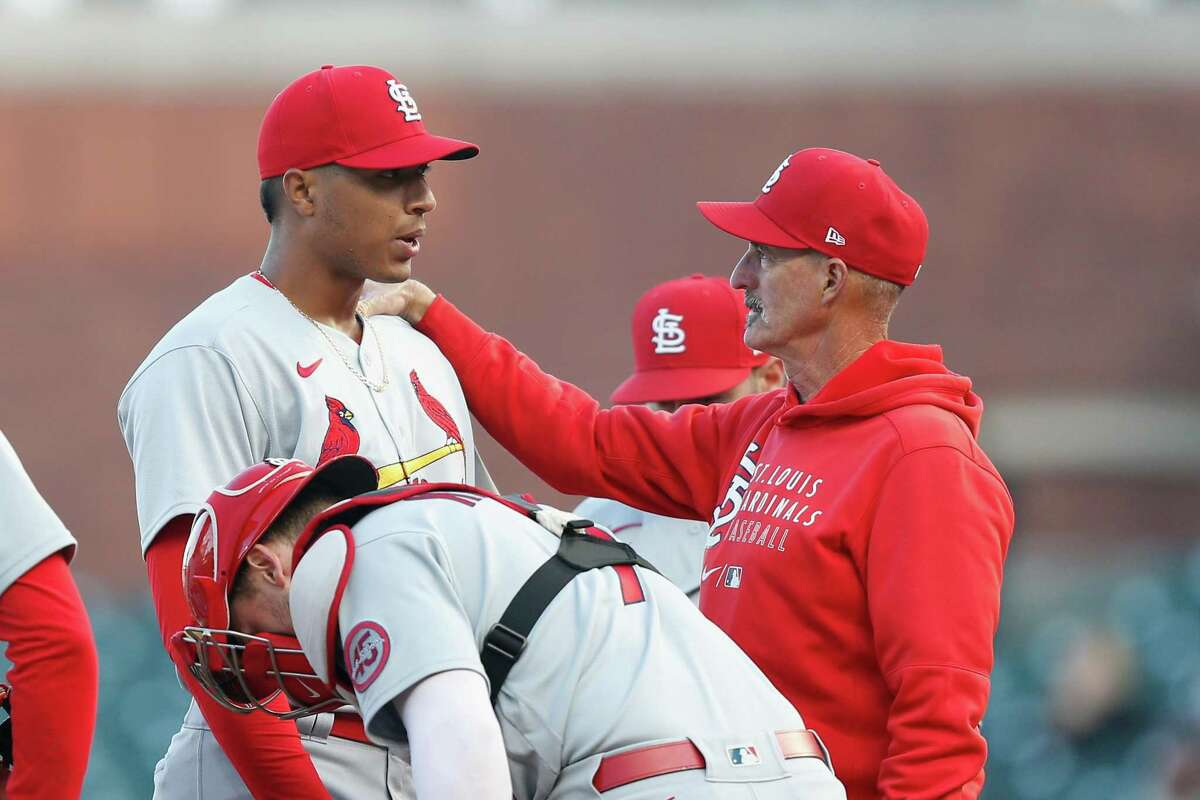SAN FRANCISCO, CALIFORNIA - JULY 07: Pitching coach Mike Maddux #31 of the St. Louis Cardinals talks to starting pitcher Johan Oviedo #59 in the bottom of the first inning against the San Francisco Giants at Oracle Park on July 07, 2021 in San Francisco, California. (Photo by Lachlan Cunningham/Getty Images)