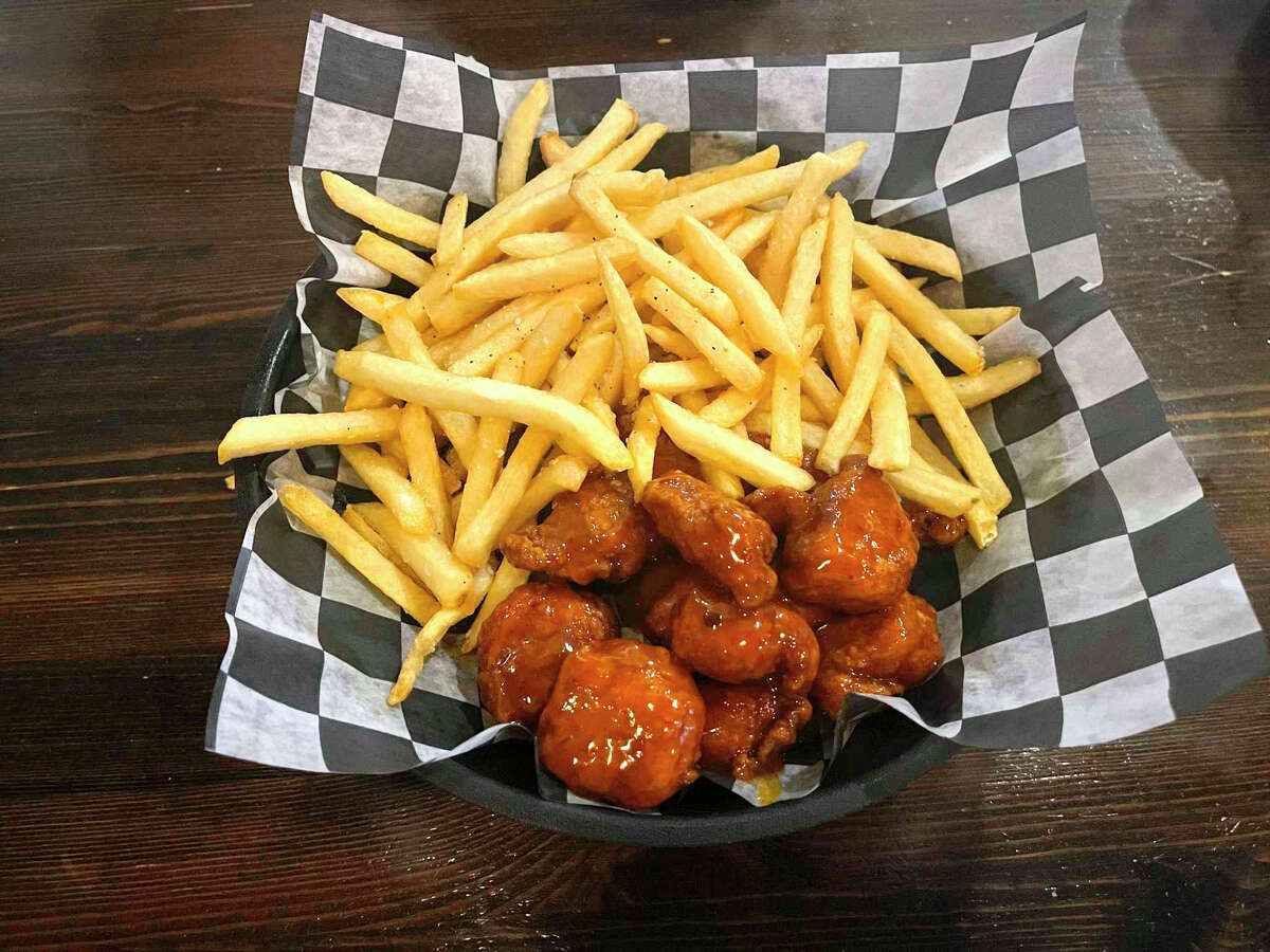 A basket of the mango habenero boneless wings, with a side of fries. Highly recommended to anyone hwo enjoys a little kick to their meal.